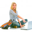 Surprised teenager sitting on floor with backpack — Stock Photo #8638957