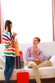Young man helping her girlfriend to choose dress — Foto Stock