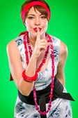 Sensual girl with finger near mouth showing silence gesture. Pin-up and ret — Stock Photo