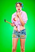 Sensual woman blowing on fingers striked by hammer. Pin-up and retro style — Stock Photo