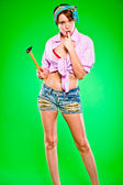 Sensual woman licking fingers striked by hammer. Pin-up and retro style . — Stockfoto