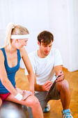 Personal trainer working with client — Stock Photo