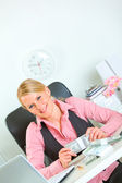Modern business woman with pack of dollars at office desk — ストック写真