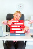 Work is done! Smiling business woman with pile of folders showin — Stock Photo