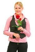 Smiling modern business woman with red roses in hand — Stock Photo