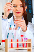 Medical doctor woman conducting tests in laboratory — Stock Photo