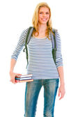 Cheerful teengirl with schoolbag holding books in hand — Stock Photo