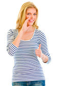 Smiling beautiful teen girl reporting good news and showing thumbs up gestu — Stock Photo