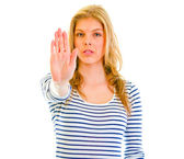 Portrait of serious teen girl showing stop gesture — Stock Photo