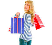 Smiling teen girl with shopping bags — Stock Photo