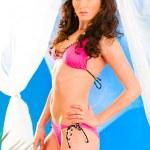 Glamour style photo of beautiful girl in pink bikini posing in summerhouse — Stock Photo