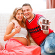 Smiling couple showing their unborn child's sonogram — Stok fotoğraf