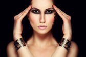 Portrait of mystic woman with extravagant makeup. Retouched — Stock Photo