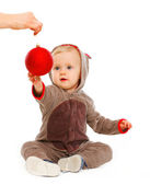 Lovely baby stretching to Christmas ball — Stock Photo