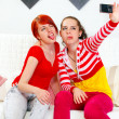 Funny girlfriends showing tongues while photographing themselves — Stock Photo #8651383