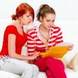 Stock Photo: Attentive girl soothing reading letter with bad news girlfriend