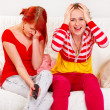 Girlfriends upset by TV program — Stock Photo #8651532