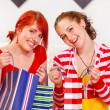 Two smiling girlfriends with shopping bags — Stock Photo