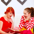 Two studying at home girlfriends surprised — Stock Photo