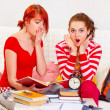 Stock Photo: Two studying girlfriends shocked because running out of time