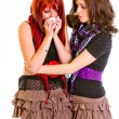 Attentive young girl calming her sad girlfriend — Stock Photo #8652025