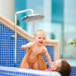 Mother playing with baby while taking shower — Stock Photo