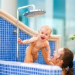 Mom playing with baby while taking shower — Stock Photo