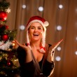 Portrait of happy young woman near Christmas tree — Stock Photo #8653146