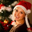Portrait of beautiful woman near Christmas tree — Stock Photo #8653159