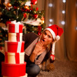 Surprised beautiful woman near Christmas tree - Photo