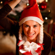 Funny portrait of happy woman near Christmas tree — Stock Photo