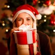 Smiling young woman near Christmas tree — Stock Photo #8653308