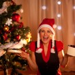 Happy young woman near Christmas with open gift — Stockfoto