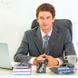 Portrait of happy modern businessman in office - Stock Photo