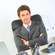 Portrait of modern businessman sitting at office desk — Stock Photo #8653794