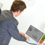 Modern businessman working on laptop — Stock Photo #8654011