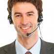 Portrait of smiling businessman with headset — Stock Photo
