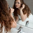 Gorgeous woman makeup in bathroom — Stock Photo #8655415