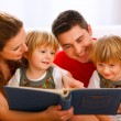 Stockfoto: Family looking photo album