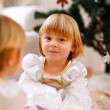 Two happy twins girl sitting with presents near Christmas tree — Stockfoto #8657877