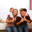 Family portrait of mother, father and twins daughters — Stock Photo