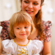 Royalty-Free Stock Photo: Portrait of mother and daughter looking on something