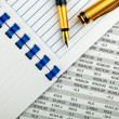 Stock Photo: Stationery and financial document