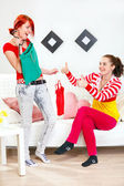 Shirt approved. Cheerful girl helping choose clothes her girlfriend — Stock Photo