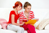Attentive girl soothing reading letter with bad news girlfriend — Stock Photo