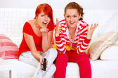 Girlfriends upset by TV program — Stock Photo
