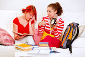 Girl showing her studying girlfriends clock — Stock Photo
