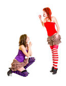 Cute girl on knees beging her strict girlfriend — Stock Photo