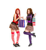 Pleased teen girl with shopping bags giving one to her happy girlfriend — Stock Photo