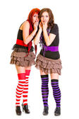 Two young surprised girlfriends standing together — Stock Photo